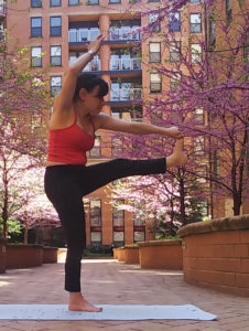 strap hand to big toe pose yoga